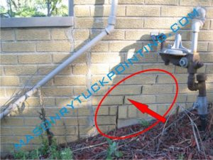 Brick repair Schiller Park IL - wall cracks caused by unevenly settling foundation