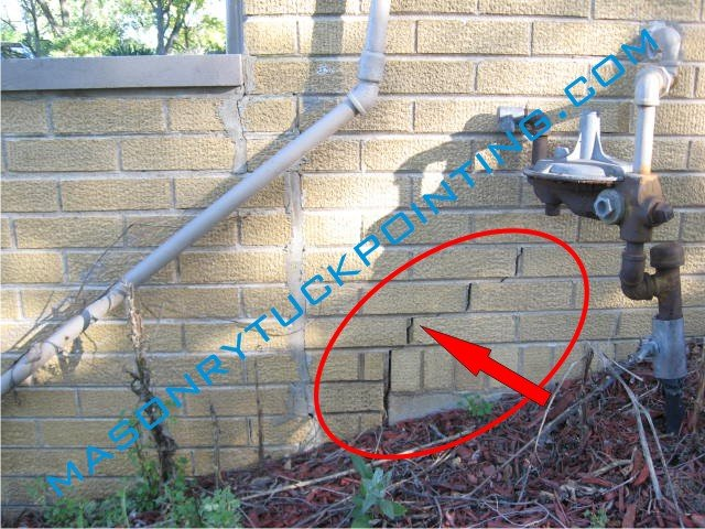 Uneven settling of house foundation results in brick wall cracks and displacement