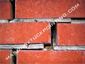 Deteriorated mortar requires repointing - tuckpointing, brickwork repair and replacement in Chicago and surrounding area