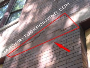Lintel replacement South Addison - displaced brick wall as a result of a corroded window lintel