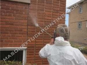 Residential tuckpointing Chicago - power washing of masonry wall