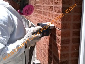 Tuckpointing in Chicago, old mortar removing with angle grinder