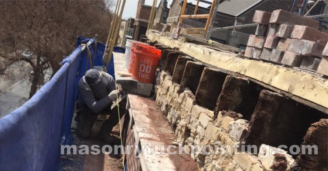 Masonry parapet wall rebuilding by EDMAR Corporation