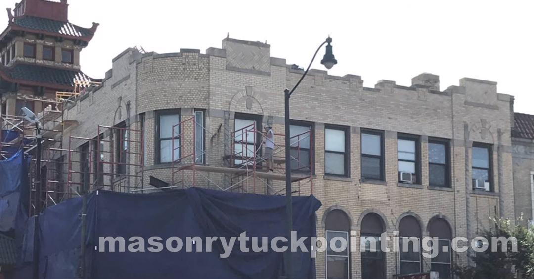 Repair and rebuilding of masonry parapet walls by EDMAR Corporation