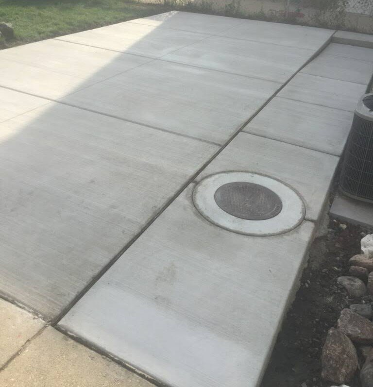 Concrete parking pad installation by EDMAR Corporation Masonry