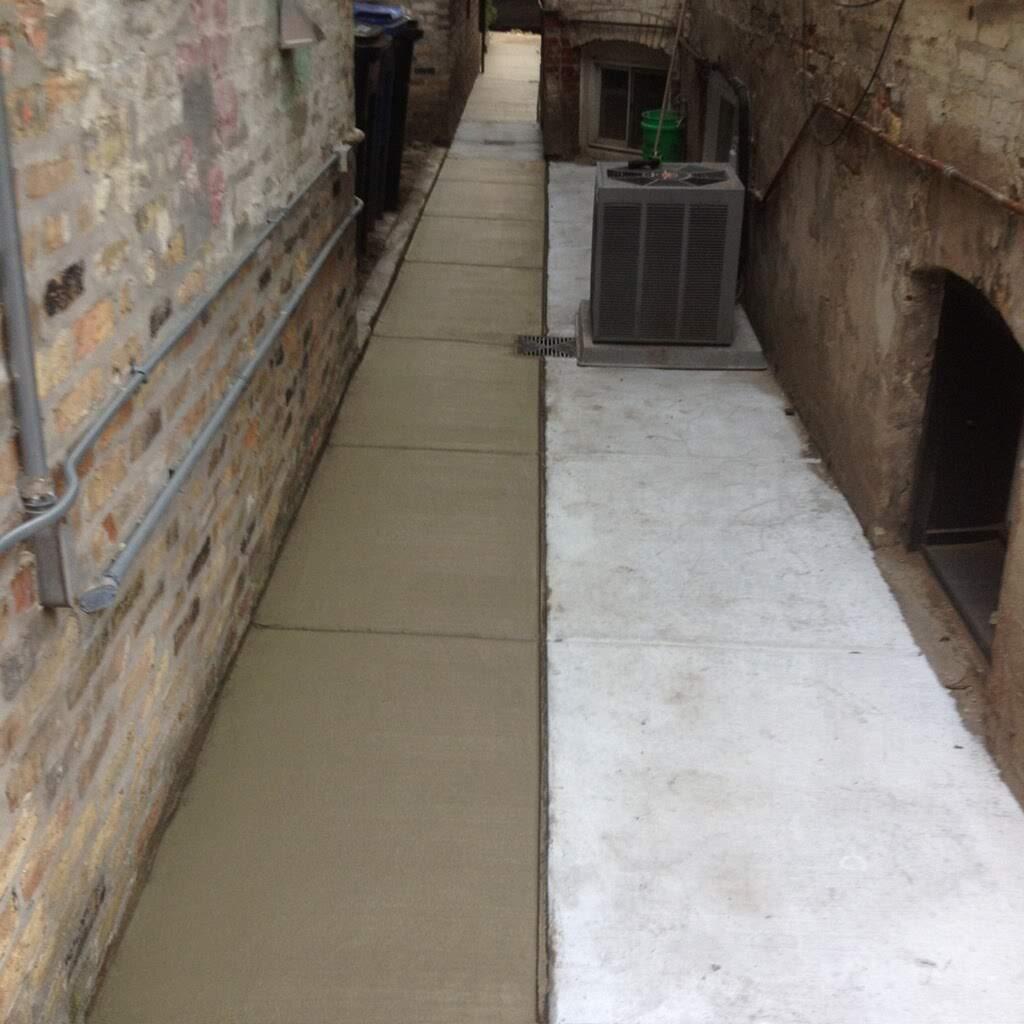 Concrete sidewalk installation by EDMAR Corporation Masonry